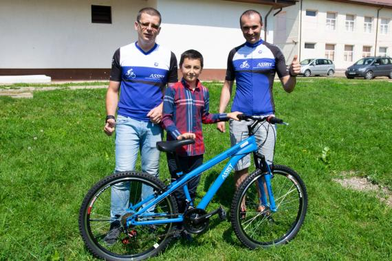 ASSIST Software giving bikes for children