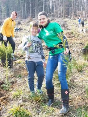 ASSIST Software volunteers planting trees in order to contribute to the reforestation efforts in the area.